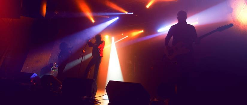 Rock band silhouettes on stage at concert