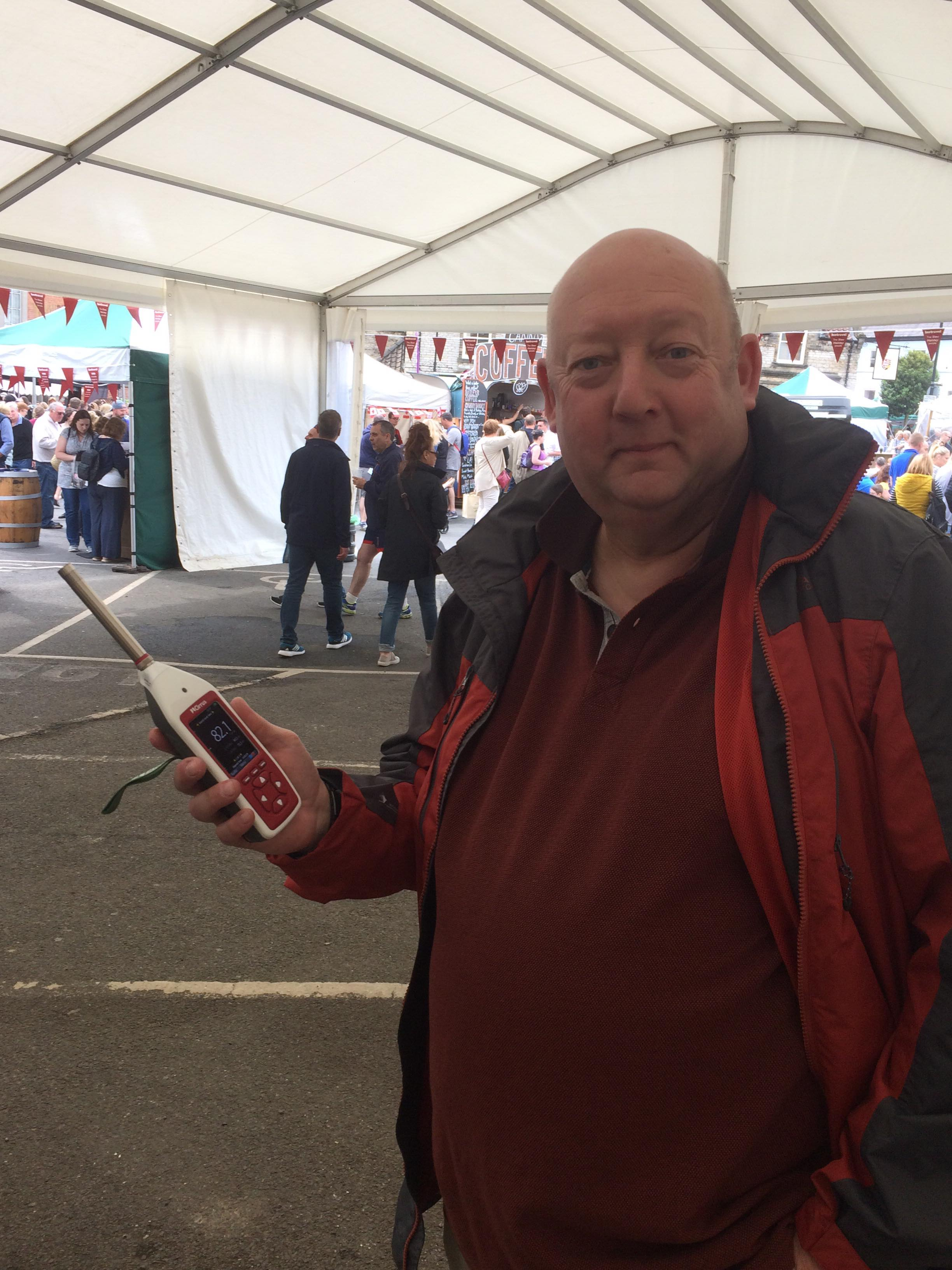 An image of sales manager Martin Ellison with an Optimus sound level meter at the Malton Food Festival