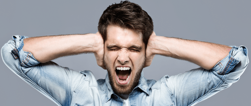 A man holding his hands over his ears, as a visual representation of noise pollution.