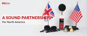 An image of the UK flag with the US flag and cirrus research plc noise measurement devices